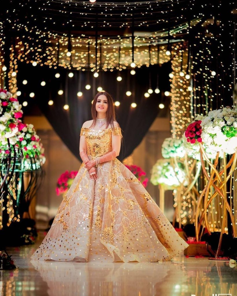 Bride in golden princess bridal gown for her wedding