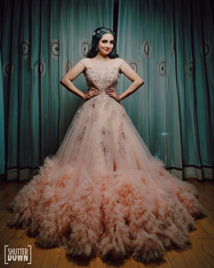 Bride in peach bridal gown