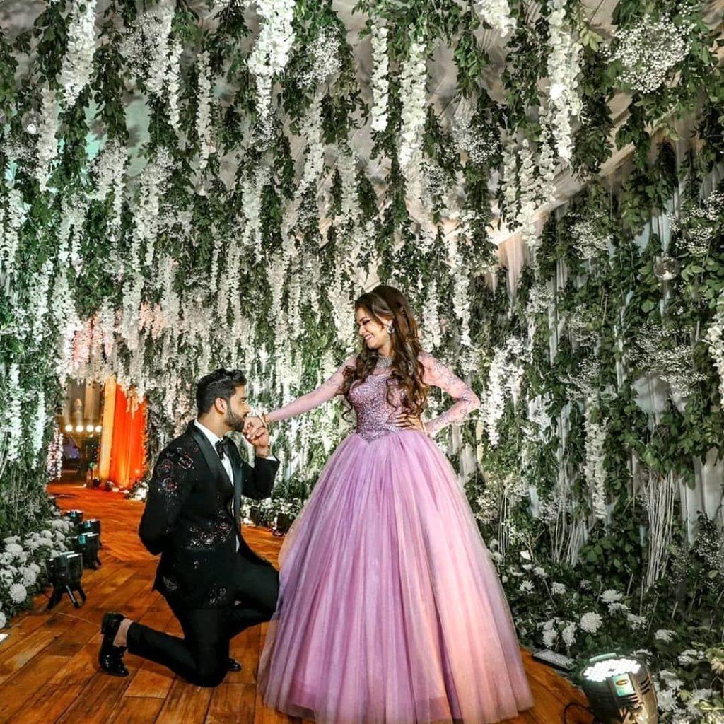 bride in purple gown & groom in black tuxedo