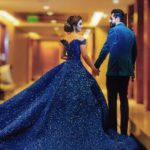 bride in blue princess gown & groom in color coordinated blue tuxedo