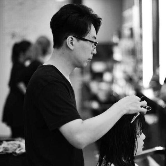 Black and white photo of Edward Kim, Korean hairstylist