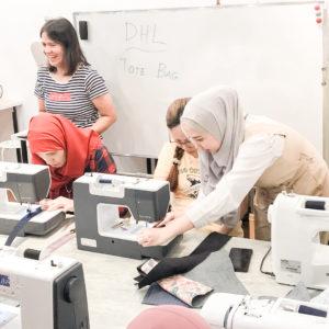 Photo of participants at a dressmaking workshop