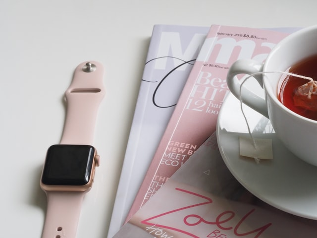 Photo of tea, a watch and reading materials