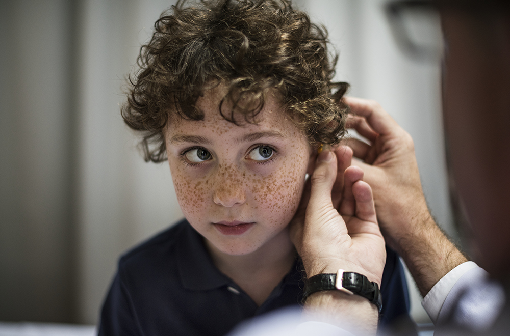 Young having his ears checked