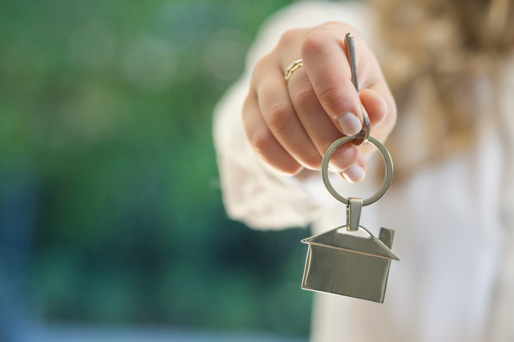 Real estate agent handing over the keys to a home.