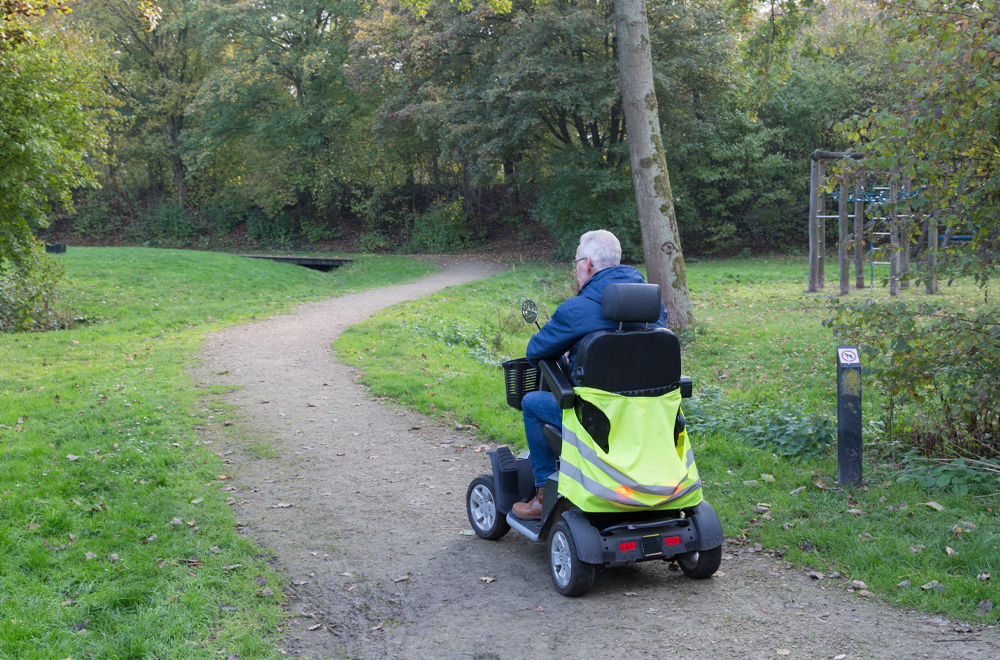 Man on a motorised wheelchair in Maarssen, the Netherlands; mobility