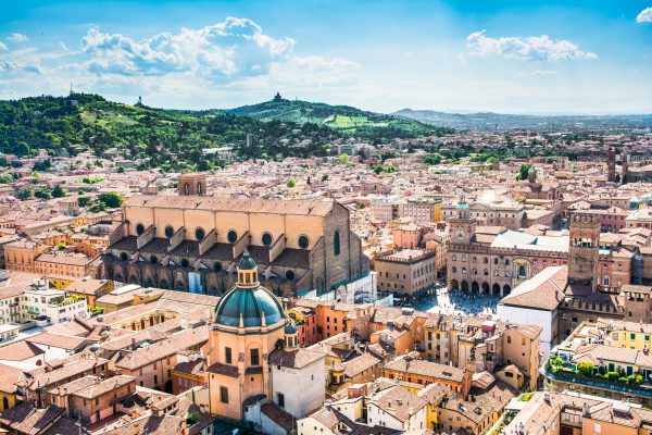"""Bologna,Italy-May 17,2014:panorama of Bologna view from the famous """"Asinelli"""" tower located in the centre of the city.You can see the dome of St. Petronio and the central main square."""