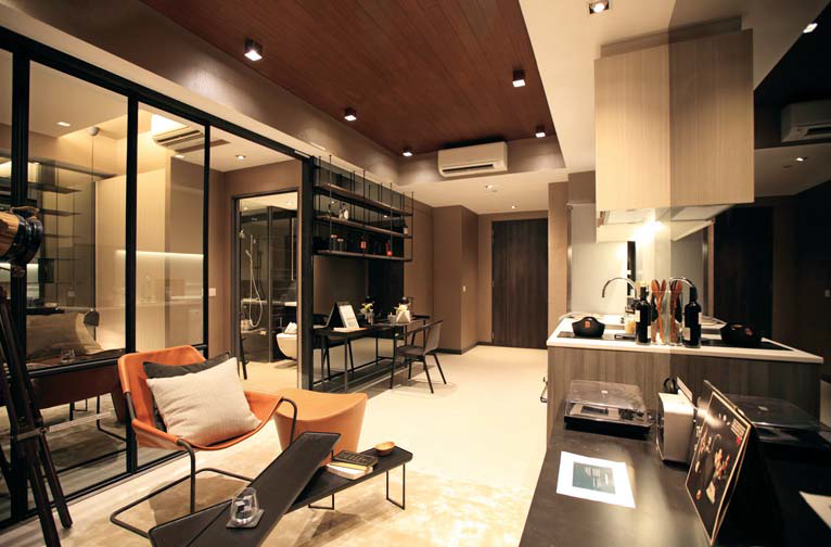 Showflat of a one-bedroom unit at Gem Residences. The fully fitted unit comes with Smeg appliances such as oven, refrigerator and washer-dryer.