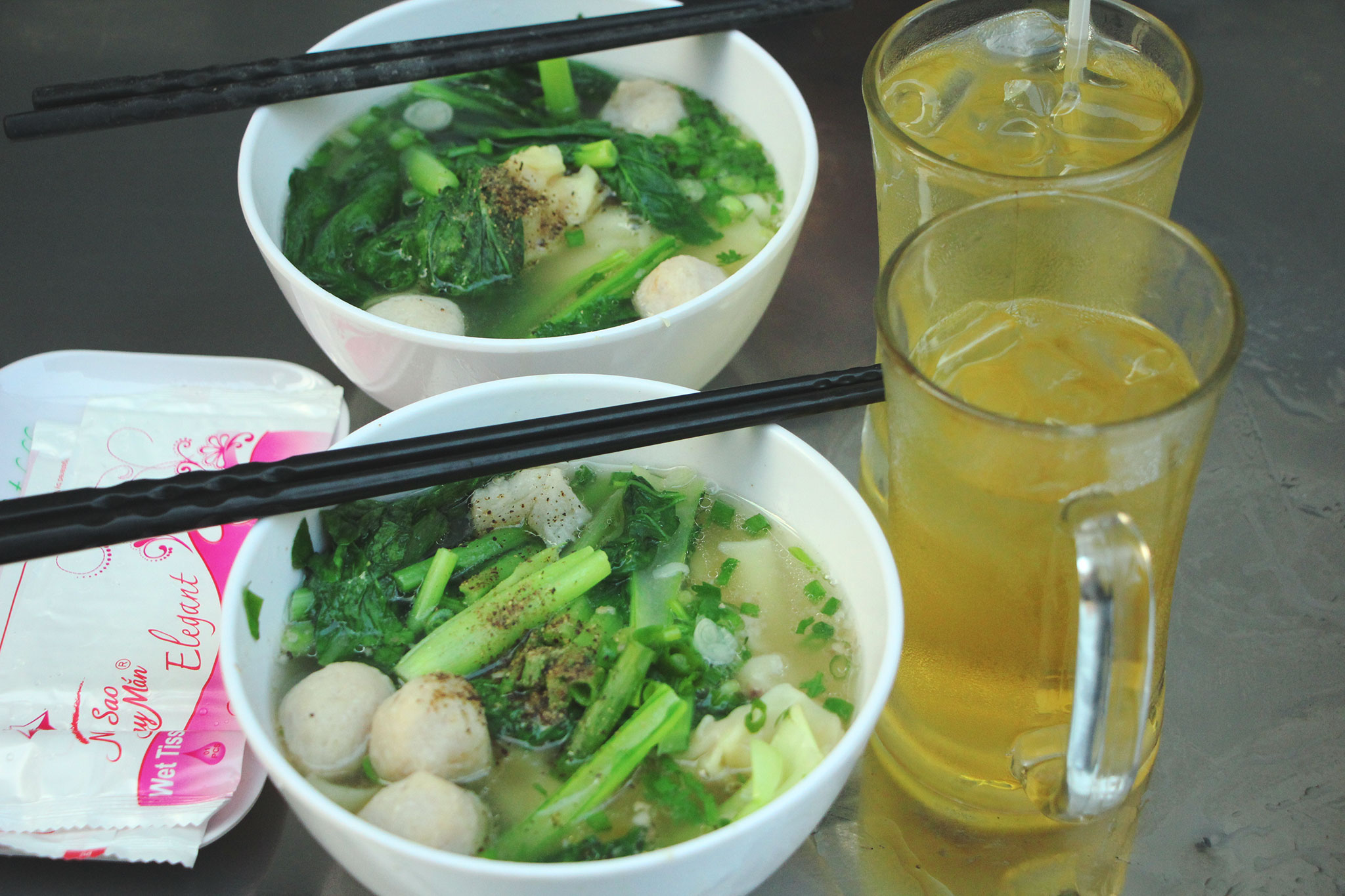 Noodles with meatballs and dumplings, with cool and refreshing iced-tea to start your day